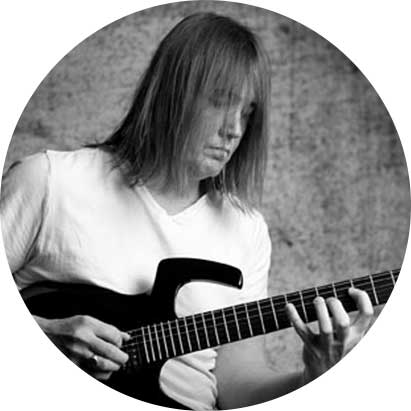 Greyscale photo of Glenn Riley playing the guitar